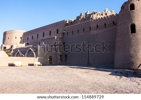 Fortification walls of ancient citadel of Bam, during reconstruction of damage by 2003 earthquake (March 2013) - stock photo