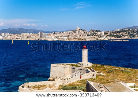 Fortifications and lighthouse on the island of If. In the background, Marseille, France