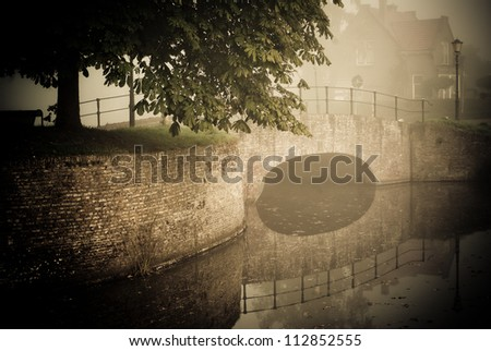 fortified bridge reflection in water