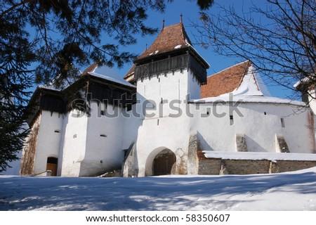 Fortified church of Viscri (Weisskirch, Szaszfeheregyhaza) in Transylvania, Romania. UNESCO heritage - stock photo