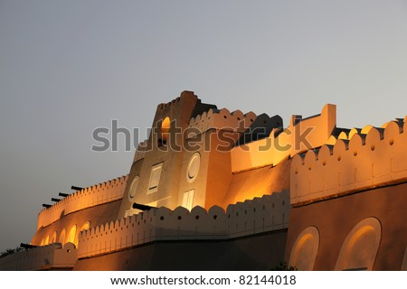 Fortified gate to Muttrah at night. Muscat, Sultanate of Oman - stock photo
