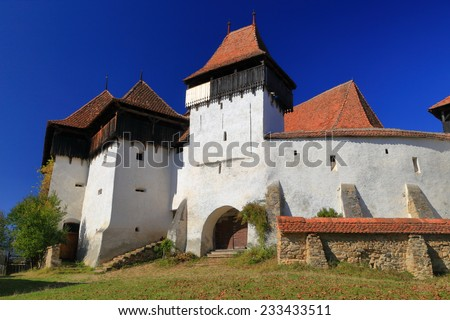 Fortified walls and towers of medieval church from UNESCO world heritage list in Viscri village, Transylvania, Romania - stock photo