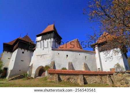 Fortified walls around medieval church listed on UNESCO world heritage in Viscri , Transylvania, Romania - stock photo