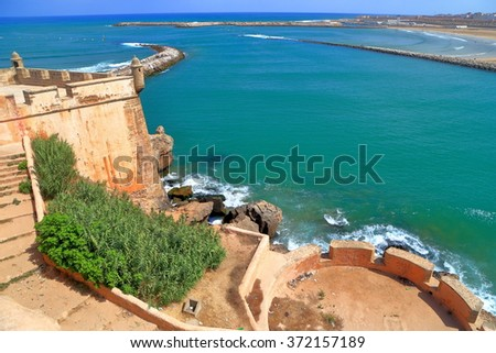 Fortified walls of the Kasbah of the Udayas above the Bou Regreg river and distant Atlantic ocean, Rabat, Morocco - stock photo