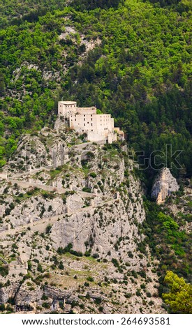 Fortress on the cliff over the medieval town of Entrevaux. (Alpes-de-Haute-Provence, France)  - stock photo