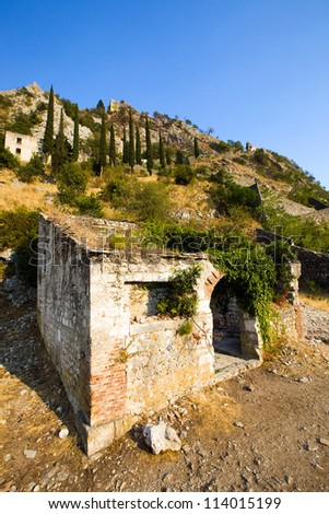 fortress ruins _ the ruins which have remained from a fortification of a fortress. Montenegro, city of Kotor - stock photo