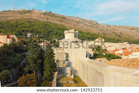 Fortress Wall of old town Dubrovnik in Croatia, shot in the warm light of the sunset. - stock photo
