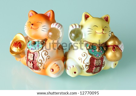 Fortune and prosperity cats - stock photo