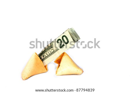 Fortune cookie broken in half with cash sticking out. - stock photo