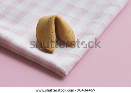Fortune cookie on a napkin - stock photo