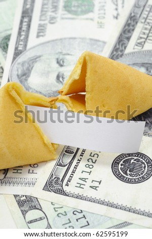 Fortune cookie with blank fortune on money. - stock photo