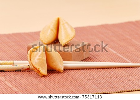 Fortune Cookie with Chopsticks - stock photo