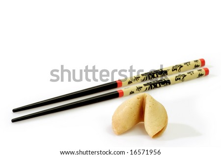 Fortune Cookie with Chopsticks on bright Background - stock photo