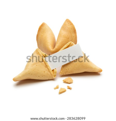 fortune cookie with crumbs and note on white background - stock photo