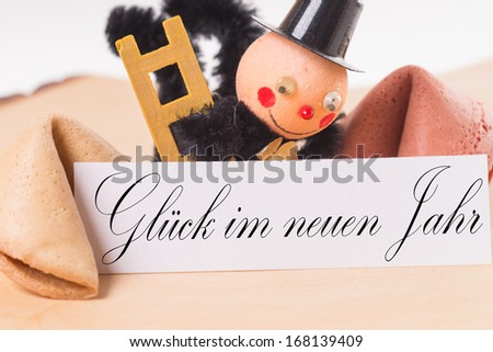 fortune cookies and Chimney Sweep with sign and the german words Luck in the new year / Good Luck - stock photo