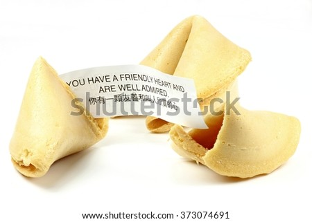 fortune cookies isolated on white background (bilingual text - translation is shown in the image) - stock photo