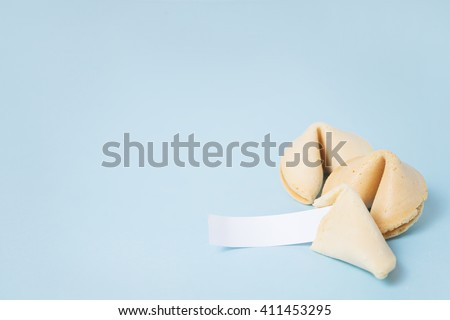 Fortune cookies on the blue background - stock photo