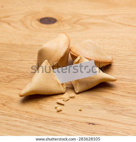 fortune cookies on wooden background - stock photo