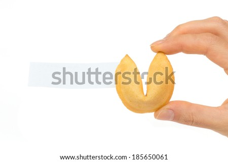 Fortune cookies with blank slip in hand isolated on white background  - stock photo