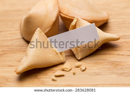 fortune cookies with note on a wooden table - stock photo