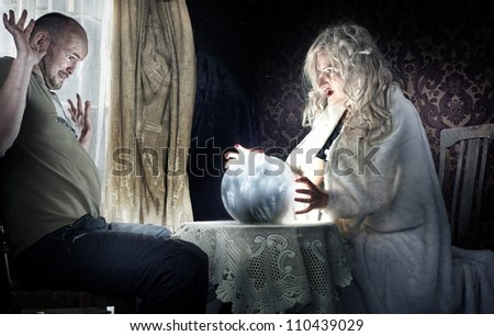 Fortune-teller and a surprised man - stock photo