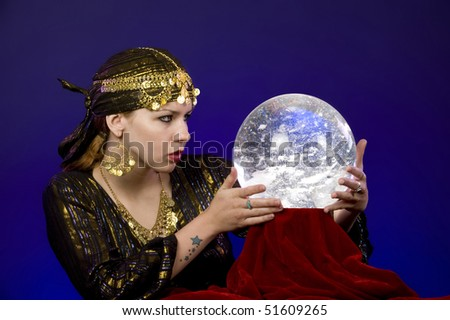 Fortune-teller divines with crystal ball. - stock photo