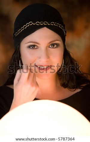 Fortune teller luring customers into her tent - stock photo