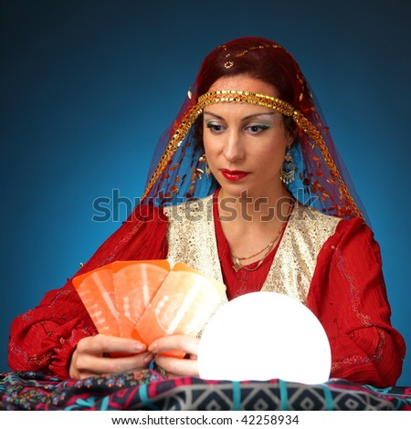fortune-teller telling fortunes by cards - stock photo
