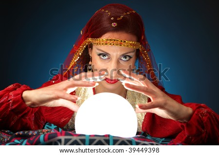 fortune-teller with a shining crystal ball - stock photo