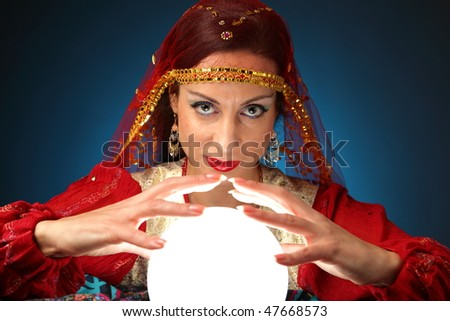 fortune teller with a shining crystal ball - stock photo