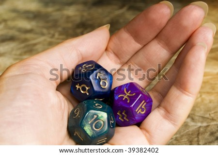 fortune teller with astrological dices - stock photo