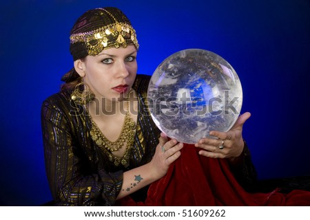 Fortune-teller with crystal ball - stock photo