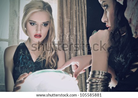 Fortune teller with her crystal ball - stock photo