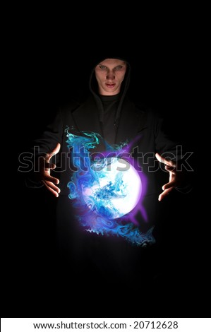 Fortune teller with magic crystal ball - stock photo