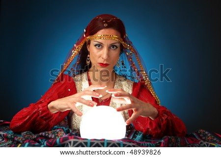 fortune-teller with shining crystal ball - stock photo