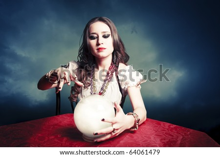 fortuneteller with crystal ball - stock photo
