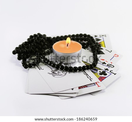 Fortunetelling cards with a candle and rosary - stock photo