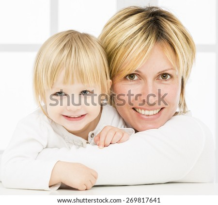 Forty years mother with her two years old baby girl - stock photo