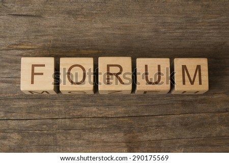 FORUM text on a wooden background - stock photo