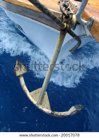 Forward part of a boat with an anchor on the move - stock photo
