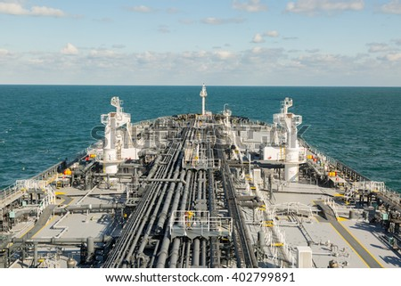 Forward part of a crude oil tanker in the open sea. - stock photo