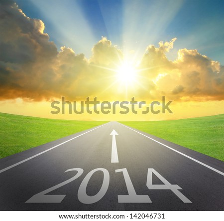 Forward to 2014 new year concept , asphalt road with arrow , date and beautiful sunset and sunshine - stock photo