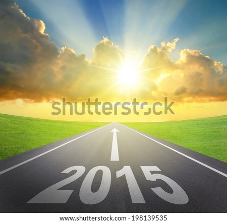 Forward to 2015 new year concept , asphalt road with arrow , date and beautiful sunset and sunshine - stock photo