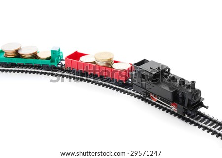 Forwarding valuable cargo: miniature train and and coins with copyspace - stock photo