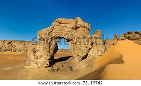 Forzhaga Arch - Huge natural rock arch - Akakus (Acacus) Mountains, Sahara, Libya - stock photo