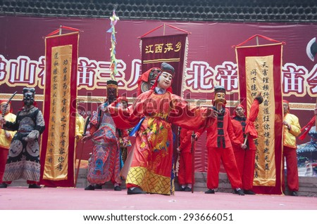 FOSHAN - April 4:Taoist god's birthday, temples non-material cultural exhibitions, from pingxiang masked men dressed in traditional costumes performing on the stage April  4, 2011 in Foshan, China - stock photo