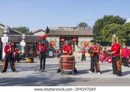 FOSHAN, CHINA - February 9, 2016: Lion dance team in front of the museum square performances in the second day of the Chinese New Year, every festival, Chinese people like lion dance to celebrate. - stock photo