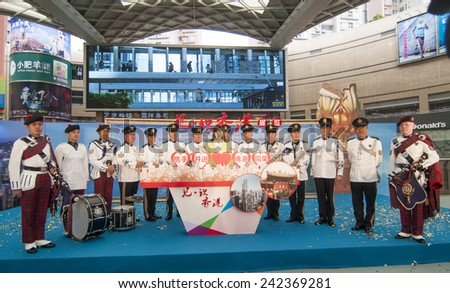FOSHAN - Dec 18:Foshan and Hong Kong plaza cultural exchange activities in foshan, Hong Kong police band dressed in traditional Scottish costume for public performances  Dec 18, 2014 in FOSHAN, China