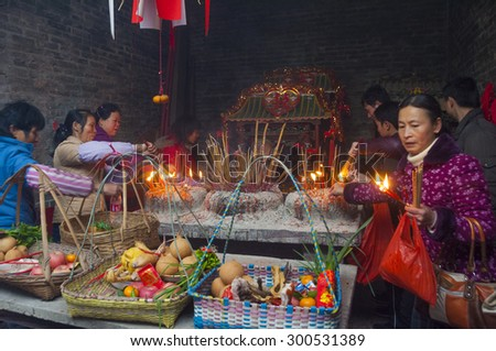 FOSHAN-February 17:The Lantern Festival that day, pond belly villagers with meat and fruit village temple to worship the gods, legend god was born in the village February 17, 2011 in Foshan, China - stock photo