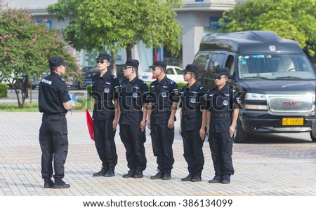 FOSHAN â?? July 12:Pearl group co., LTD. Security guards in training, Chinese soldiers after retirement, most security work to the company, this is their final destination July 12, 2015 in Foshan, China - stock photo